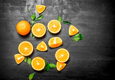 Fresh oranges with green leaves. Royalty Free Stock Photography