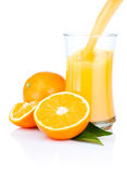 Fresh Oranges Juice Pouring into a Glass Isolated Stock Image