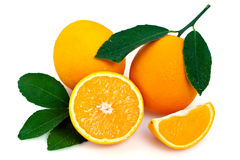 Fresh oranges and leaves. Whole and halved fresh oranges with green leaves, isolated on white background stock photos