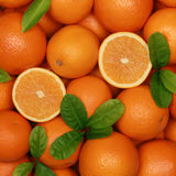 Fresh oranges with leaves Stock Photos