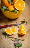 Fresh oranges with leaves in a cup  . Stock Image