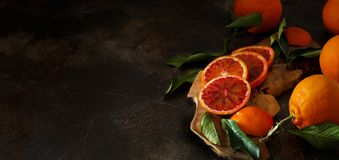 Fresh  oranges with leaves. On an old table Stock Photography