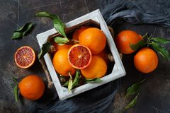 Fresh  oranges with leaves. On an old table Royalty Free Stock Images