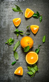 Fresh oranges with leaves. On stone table. Stock Photography