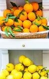 Fresh oranges and lemons on the étagère Stock Photo