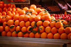 Fresh oranges at marketplace Royalty Free Stock Images