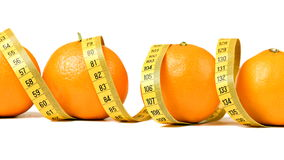 Fresh oranges with measuring tape Royalty Free Stock Photos
