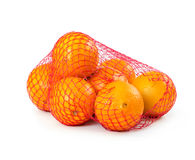 Fresh oranges in mesh sack. On white background Royalty Free Stock Images