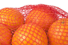 Fresh oranges in net. Royalty Free Stock Photos