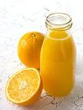 Fresh oranges and orange fresh juice Stock Images