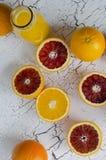 Fresh oranges and orange fresh juice. On cracked wood  background Stock Photography