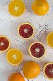 Fresh oranges. And orange fresh juice on cracked wood  background Royalty Free Stock Photos