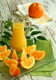 Fresh oranges and orange juice in glass Stock Photography