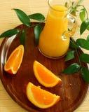 Fresh oranges and orange juice in glass Stock Image