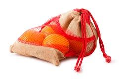 Fresh oranges in plastic mesh sack Royalty Free Stock Photos
