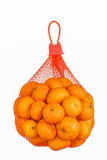 Fresh Oranges in Plastic Mesh Sack isolated on white. Stock Images