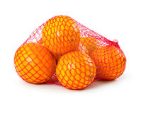 Fresh oranges in plastic mesh sack. Isolated on white background Stock Image