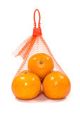 Fresh Oranges in Plastic Mesh Sack. On White Background Royalty Free Stock Photography