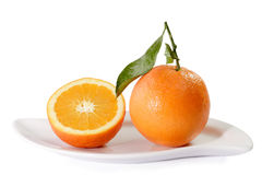 Fresh Oranges on a  plate Stock Images