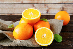 Fresh oranges on sacking Royalty Free Stock Photography