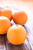 Fresh oranges in shopping net or bag. On wooden rustic table, copy text space Royalty Free Stock Photography