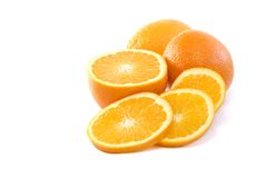 Fresh Oranges sliced half and whole  copy space Stock Images