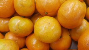 Fresh oranges in supermarket for sale, pile of orange in market for texture stock image