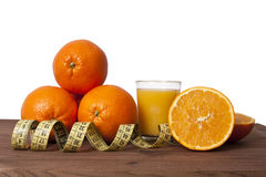 Fresh oranges and tape Stock Images
