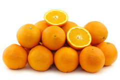Fresh oranges and two halves Royalty Free Stock Photography