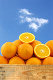 Fresh oranges and two halves Stock Images