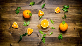 Fresh oranges whole, cut and the leaves. Royalty Free Stock Photography
