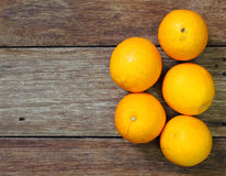 Fresh oranges on wooden Royalty Free Stock Photography