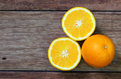 Fresh oranges on wooden Stock Images