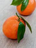 Fresh oranges on wooden background Royalty Free Stock Photos