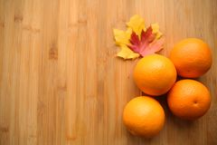Fresh oranges on wooden bamboo background royalty free stock photography