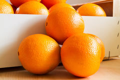Fresh Oranges in a wooden box. Closeup, Format Filling Stock Photo