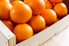 Fresh Oranges in a wooden box. Closeup, Format Filling Royalty Free Stock Images