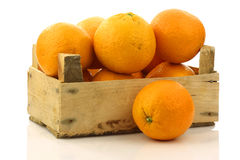 Fresh oranges in a wooden box royalty free stock photos
