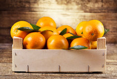 Fresh oranges in wooden box Royalty Free Stock Images