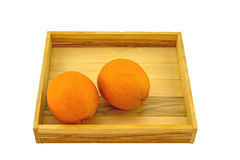 Fresh oranges  in  wooden box on white background Royalty Free Stock Images