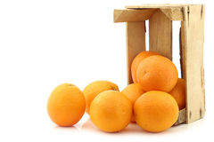 Fresh oranges in a wooden crate Royalty Free Stock Images