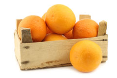 Fresh oranges in a wooden crate Stock Photography