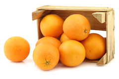 Fresh oranges in a wooden crate Stock Photos