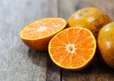 Fresh oranges on wooden Royalty Free Stock Image