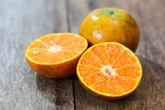 Fresh oranges on wooden Stock Photography