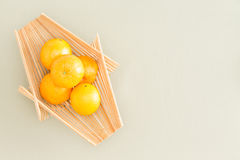 Fresh Oranges on Wooden Tray at the Table Stock Photos