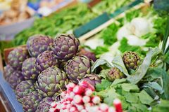 Fresh organic artichokes on farmers market. In Paris, France Stock Images