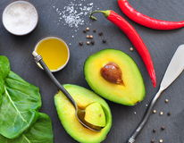 Fresh organic avocado, chili pepper, spinach, seasalt, olive oil, Stock Image