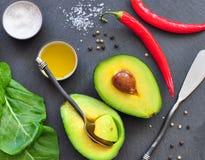 Fresh organic avocado, chili pepper, spinach, seasalt, olive oil,. Fresh organic avocado, chili pepper, spinach, seasalt and olive oil Stock Image