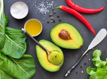Fresh organic avocado, chili pepper, spinach, seasalt, olive oil, Stock Photography